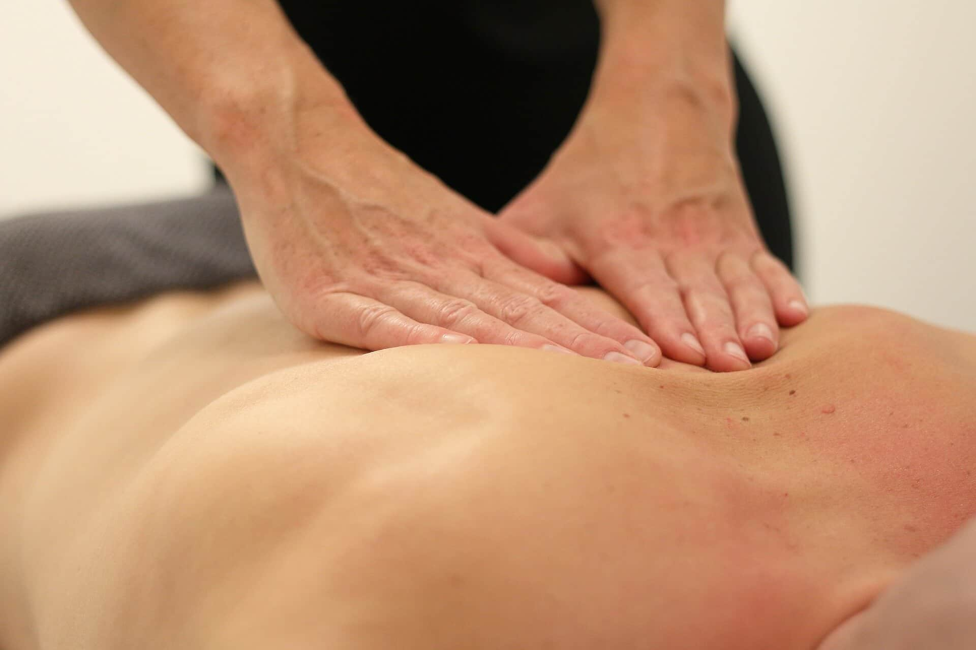 man giving lymphatic draining massage in Sutton clinic